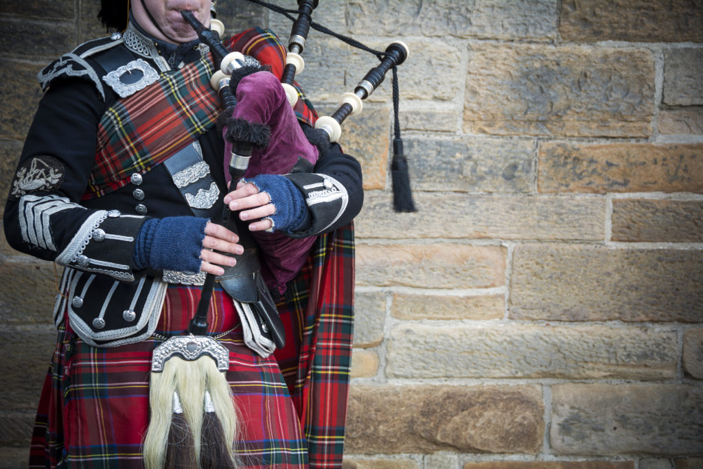 Playing the bagpipes on streets of Edinburgh
