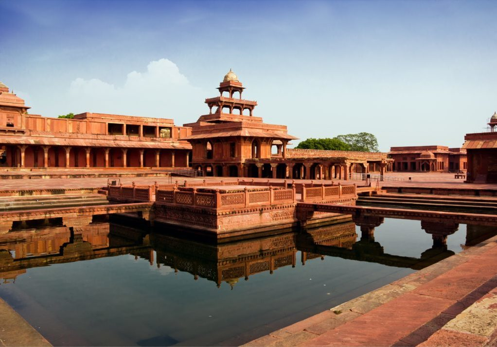 Fatehpur Sikri mirrored in a water pool in India