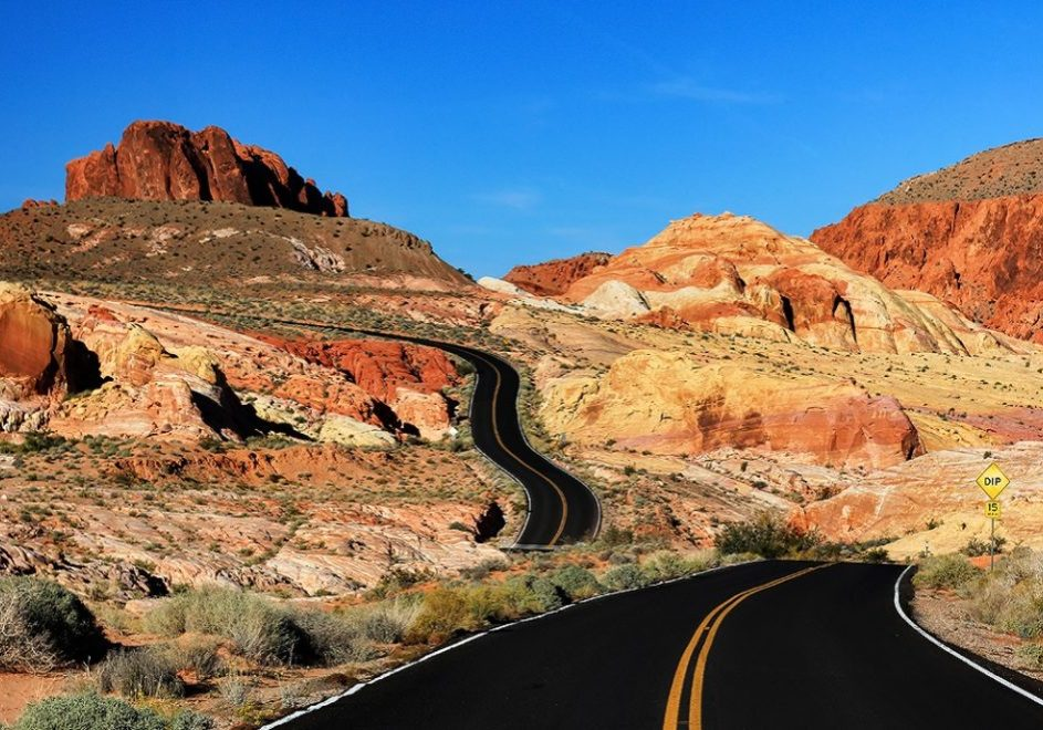 The road through Rainbow Vista at the Valley of Fire State Park is in Nevada.  Valley of Fire State Park is the oldest state park in Nevada, USA. It covers an area of almost 42,000 acres and was dedicated in 1935.   http://en.wikipedia.org/wiki/Valley_of_Fire_State_Park